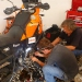 Fernando and Marcello take right away care of the bike, as they don\'t have any oil, they fly it in from la Paz, arriving the same afternoon...