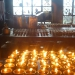 At the monestary close to Mr Lama\'s residence we saw this room full of candles