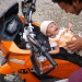 The manager of our hotel in Rishikesh playing with this sweet baby on Martin\'s bike