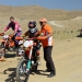 This young boy who can hardly get up the motocycle is a junior champion of Iran