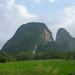 Spectacular rock formations in the middle of green plains on the way to Kangar