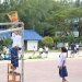 Kids at Koh Li Pe playing their kind of basket ball, with a